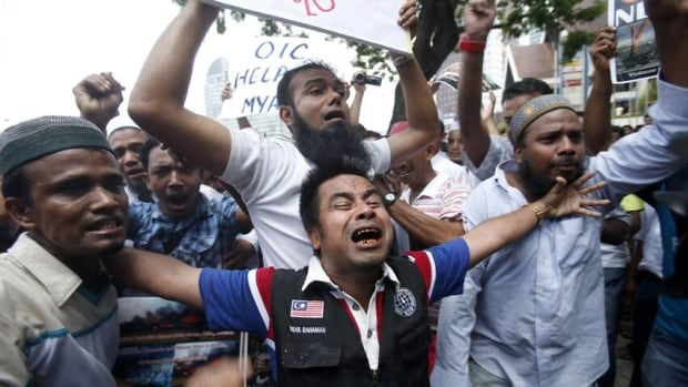 Burmese Muslims living in Malaysia shout slogans during a protest against ethnic unrest between Buddhists and Muslims in Meikhtila. Authorities have imposed a dusk-to-dawn curfew in three townships after anti-Muslim religious violence touched new parts of the country.