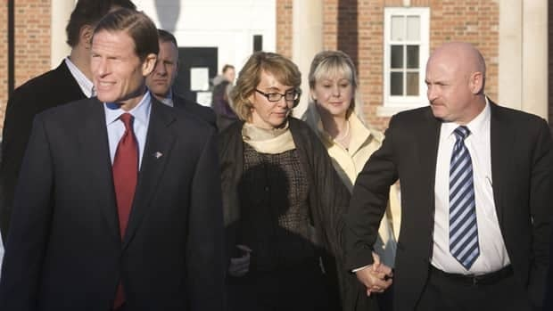 U.S. Senator Richard Blumenthal, left, former U.S. congresswoman Gabrielle Giffords, centre, and her husband, former astronaut Mark Kelly, right, met with the families of victims from the mass shooting spree at a Newtown, Conn., elementary school.
