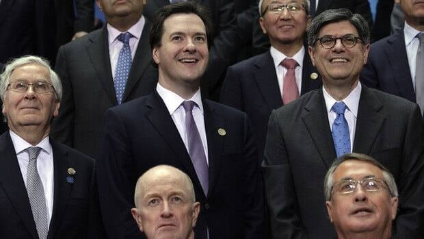 Bank of England governor Mervyn King, left, Britain's chancellor of the exchequer, George Osborne, centre, and U.S. Treasury Secretary Jack Lew during a photo-op at a meeting of G20 finance ministers and central bank governors in Washington. G20 nations committed to establishing fiscal targets as a way to spur eocnomic growth.
