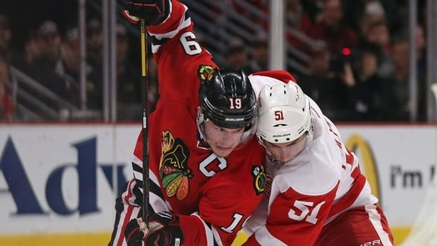 Blackhawks centre Jonathan Toews, left, finally battled to his first playoff goal this season Saturday night against the Detroit Red Wings.