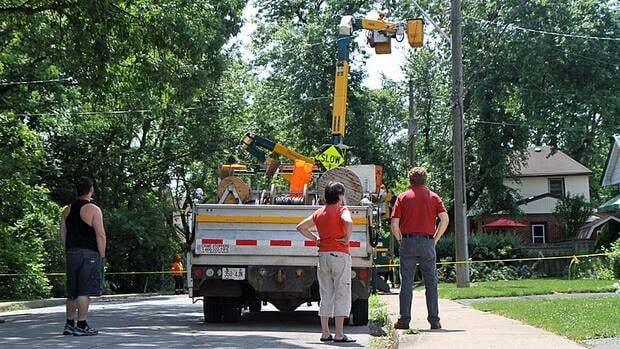 Crews work to restore power to Hamilton's North Westdale neighbourhood on Sunday afternoon. Horizon Utilities said service returned to the area around 5 p.m., almost 48 hours after the outage began.