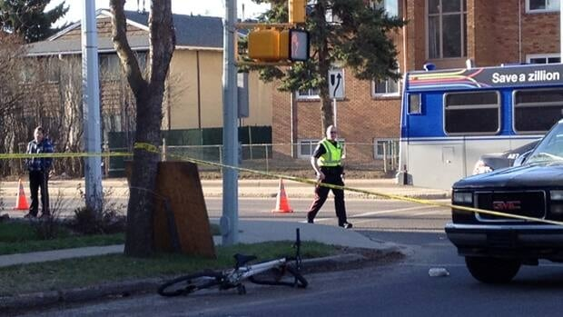A bicycle lies at 107th Avenue and 126th Street after a cyclist was hit during the morning commute Friday.