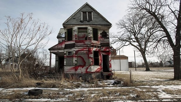 A vacant and blighted home, covered with red spray paint, sits alone in an east side neighborhood once full of homes in Detroit, Michigan January 27, 2013. The story of Detroit's decline is decades old: Its tax revenue and population have shrunk and labor costs have remained out of whack. Picture taken January 27, 2013. To match Analysis USA-DETROIT/BANKRUPTCY REUTERS/Rebecca Cook