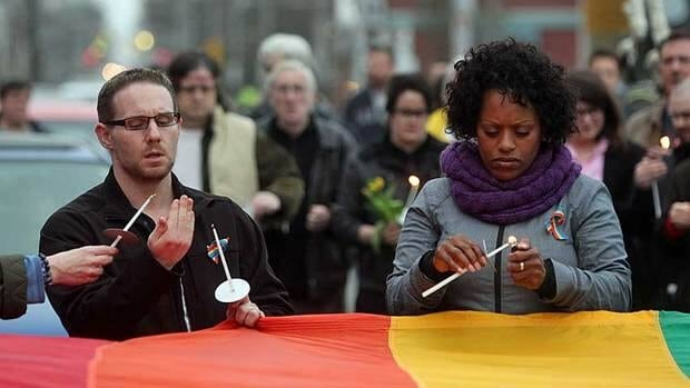 Friends of Raymond Taavel participate in a vigil on Tuesday in Halifax, Nova Scotia.