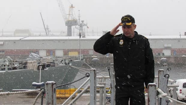 Cmdr. Wade Carter of HMCS Charlottetown salutes before boarding the ship on Thursday.