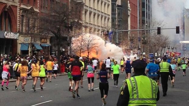 Explosions erupt as runners near the finish line during the 117th Boston Marathon on Monday.
