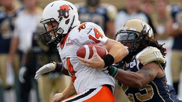 Winnipeg Blue Bombers' Jonathan Hefney tackles B.C. Lions' Travis Lulay during CFL game in Winnipeg last season.