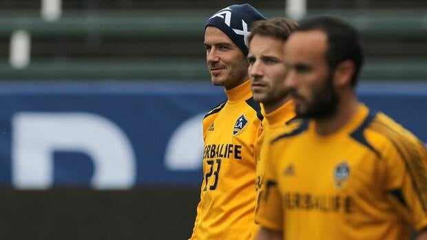 (L-R) David Beckham, Mike Magee and Landon Donovan of the Los Angeles Galaxy look on during 2012 MLS Cup - Los Angeles Galaxy Training Session at The Home Depot Center on November 30, 2012 in Carson, California.