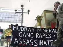 Protesters demonstrate outside the Hudbay Minerals annual general meeting in 2013. Can multinational mining companies be held liable in their country for past human rights abuses at mines they operate abroad even before their acquisition?