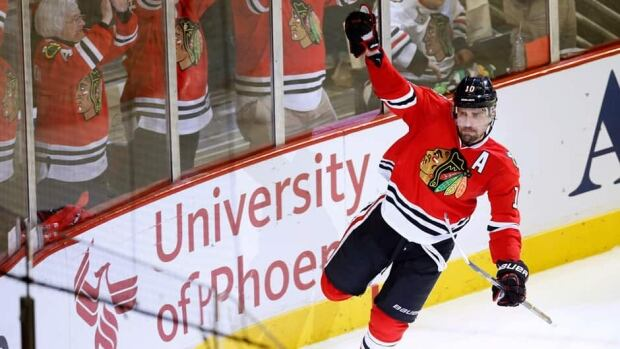 Chicago Blackhawks centre Patrick Sharp celebrates his empty net goal against the Detroit Red Wings in Game 1. Sharp has nine points in the post-season.