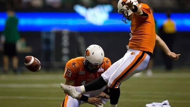 B.C. Lions kicker Paul McCallum, right, kicks a field goal as quarterback Mike Reilly holds during the second half of a game last November. Coaches have moved closer to being allowed a challenge on whether a field goal was good or not.