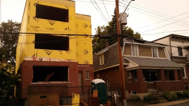 This three-storey home at 167 Aylmer Ave. is being converted into a multi-unit dormitory, say neighbours.