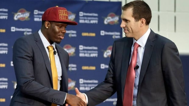 Cleveland Cavaliers first-overall pick Anthony Bennett, left, shakes hands with general manager Chris Grant on Friday after becoming the first ever Canadian selected in the No. 1 spot the night before.