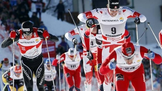 Norway's Eldar Roenning leads Canada's Alex Harvey on his way to win the Tour de Ski cross-country event at Val di Fiemme, Italy, on Saturday.
