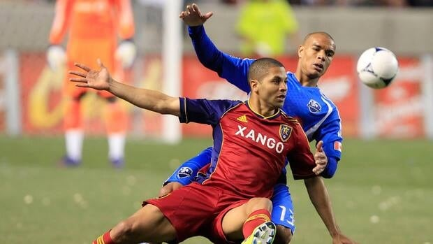 Alvaro Saborio, front, of Real Salt Lake is held by Montreal's Matteo Farrari (13) during the second half on Wednesday night in Sandy, Utah.