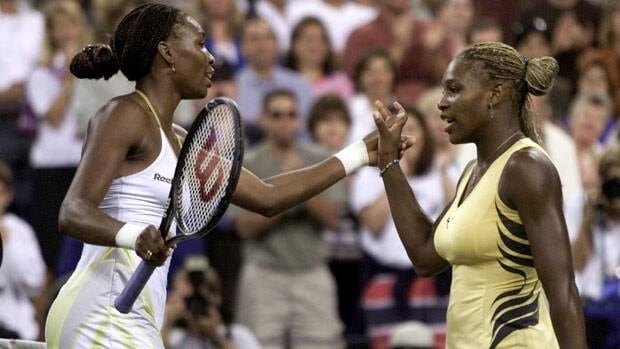 Serena Williams, right, congratulates sister Venus Williams after their first Grand Slam final meeting in 2001.