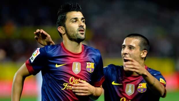 Barcelona forward David Villa, left, celebrates after scoring in extra time against Sevilla on Saturday.
