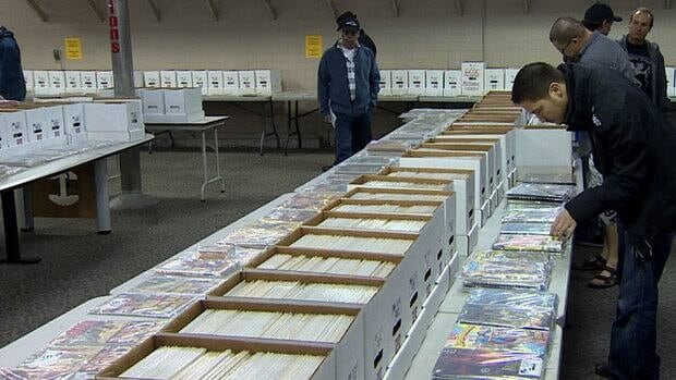 Comic book collectors inspect the 60,000 comics on sale at Able Auctions in Vancouver over the weekend.