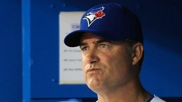 Blue Jays manager John Farrell looks on from the dugout during a game against the Oakland Athletics on Jul. 25, 2012 at the Rogers Centre.