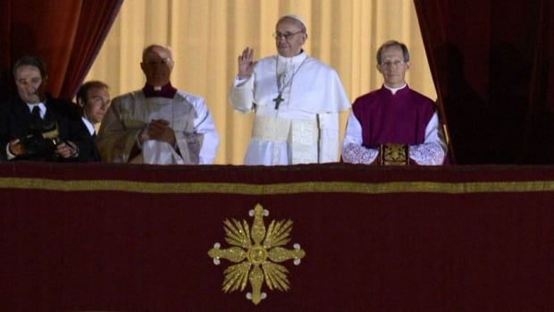 Argentina's Jorge Bergoglio, elected Pope Francis, appears at the window of St Peter's Basilica's balcony after being elected the 266th pope of the Roman Catholic Church on March 13, 2013 at the Vatican.