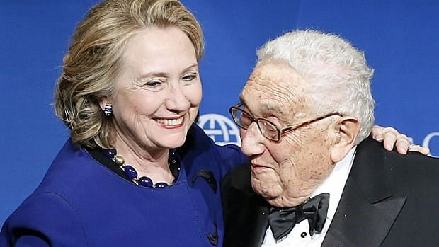 Two former secretaries of state, Hillary Clinton and Henry Kissinger, embrace earlier this month at an Atlantic Council meeting in Washington. Clinton got an award, Kissinger a round of Happy Birthday in anticipation of his turning 90 on May 27.