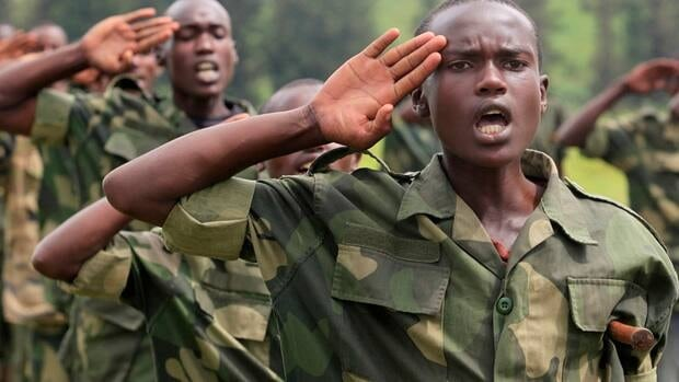 M23 recruits salute during a military training camp in October. The rebel fighters have put pressure on the Congolese government recently, publishing a list of demands including the demilitarization of a major eastern city and airport.