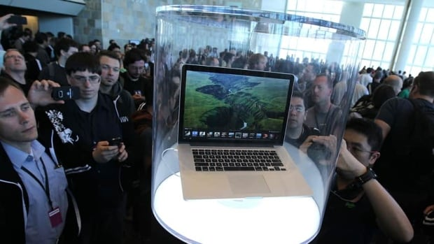 Attendees at the 2012 Worldwide Developers Conference in San Francisco in June gather around Apple's new Macbook Pro laptop, which features a screen resolution of five million pixels.