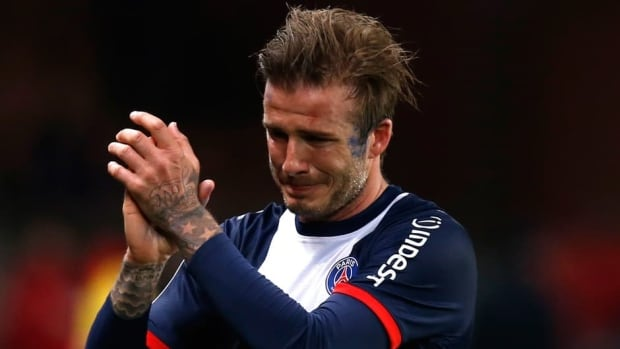 Paris Saint-Germain's David Beckham breaks down in tears as he leaves the pitch after being substituted in the 81st minute during his team's match Saturday against Brest.