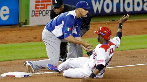 Puerto Rico's Irving Falu slides safely into third as Italy third baseman Alex Liddi awaits the throw during the fourth inning at the World Baseball Classic in Miami on Wednesday.