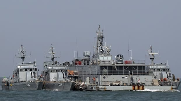 South Korean navy ships are seen at a floating base near South Korea's western Yeonpyong Island near the disputed sea border with North Korea, South Korea, in February 2012. South Korea on Friday fired warning shots at North Korean fishing boats near the boundary.