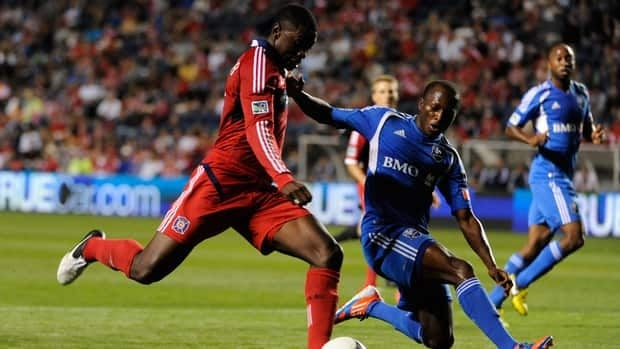 Jalil Anibaba of Chicago Fire, left, is defended by Sanna Nyassi of Montreal Impact on September 15, 2012 at Toyota Park in Bridgeview, Illinois.