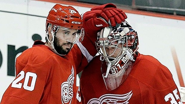 Drew Miller, left, followed teammate and goalie Jimmy Howard by signing a new deal with Detroit before the free agency period begins.