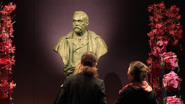 Officials look at a bust of Alfred Nobel before a Nobel Prize ceremony in 2010.