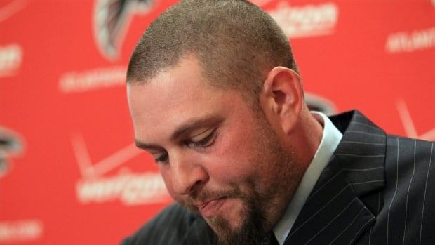 Atlanta Falcons 14-year veteran center Todd McClure reacts during a news conference to officially announce his retirement in Atlanta on Monday.