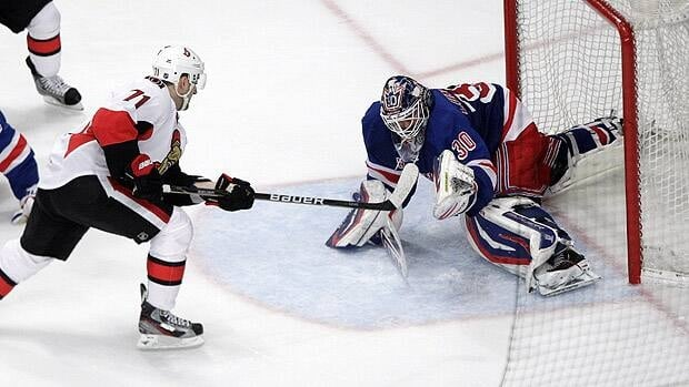 Nick Foligno of Ottawa scores past New York goalie Henrik Lundqvist late in the third to help send Game 2 in overtime.