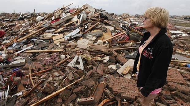 Resident Kim Schwab looks over her destroyed home in south Oklahoma City, after a tornado flattened the neighbourhood.