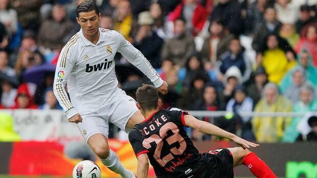 Real Madrid's Cristiano Ronaldo,  left, scored a record 43rd league goal Sunday against Sevilla.