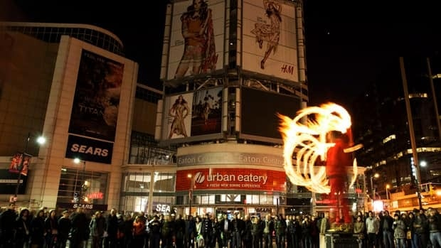 Brant Matthews, aka The Fire Guy, performs during Earth Hour at Dundas Square in Toronto on Saturday.