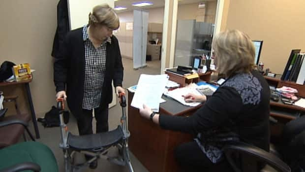 Michelle Murdoch and a worker at the Coalition of Persons with Disabilites office in St. John's.