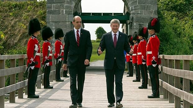 Prime Minister Stephen Harper walks with Veterans Affairs Minister Steven Blaney past an honour guard at Fort Lennox National Historic Site near Saint-Paul-de-L'ile-aux-Nois, Que. on Friday.