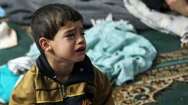 A boy who survived from what activists say is a gas attack cries as he takes shelter inside a mosque in the Duma neighbourhood of Damascus on Aug. 21, 2013.