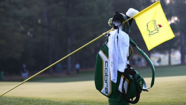 A flag leans on Rickie Fowler's bag during Monday's practice round at Augusta National.