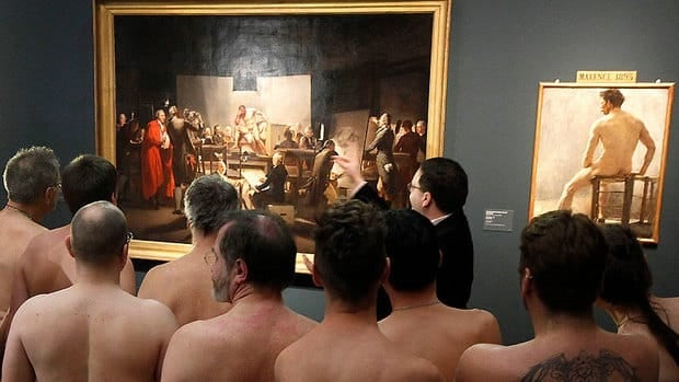 Naked museum goers are seen on Monday attending the show Nude Men from 1800 to Today during a special tour of the Leopold Museum in Vienna. The exhibit looks at how artists have dealt with the theme of male nudity over the centuries.