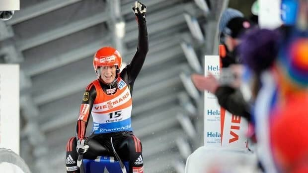 Germany's Natalie Geisenberger celebrates in the finish area after winning the women's luge Saturday in Oberhof, Germany.