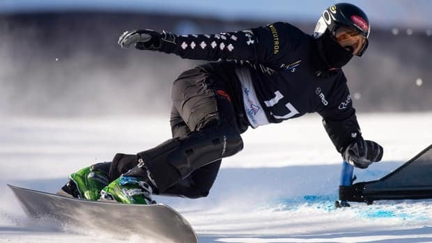 Jasey-Jay Anderson, of Mont-Tremblant, Que., races during qualifying in the men's parallel giant slalom at the FIS snowboard world championship Friday in Stoneham, Que.