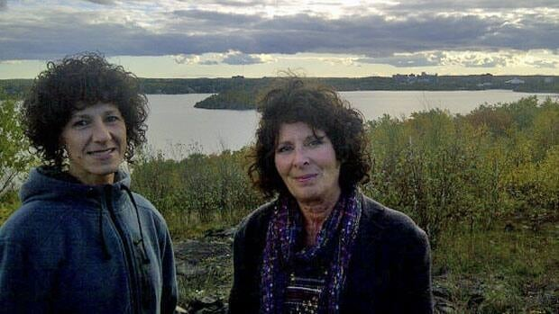 Wanda Eurich and Suzie Franklin stop at a hill overlooking Ramsey Lake, an area targeted for residential development in Greater Sudbury.