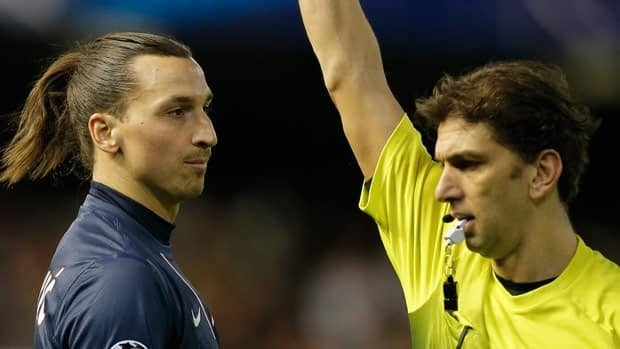 Referee Paolo Tagliavento shows a red card to PSG's Swedish forward Zlatan Ibrahimovic during the Feb. 12 match against Valencia.