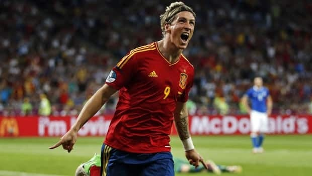Spain's Fernando Torres celebrates scoring his side's third goal during the Euro 2012 final on Sunday against Italy.