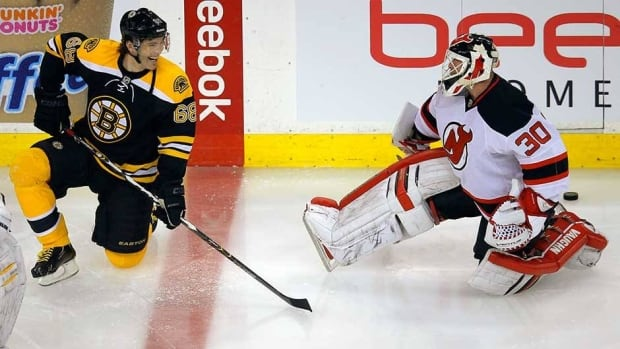 Jaromir Jagr, left, will be joining the likes of New Jersey goalie Martin Brodeur, right, and the Devils this upcoming season.