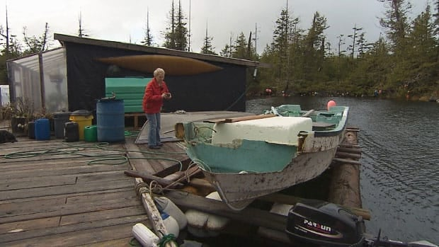 B.C. resident Jeanne Beaver takes a picture of the fishing boat that travelled more than 6,000 kilometres from the coast of Japan.